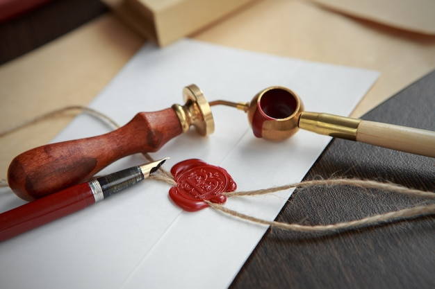 Old notarial wax seal on tied scroll,