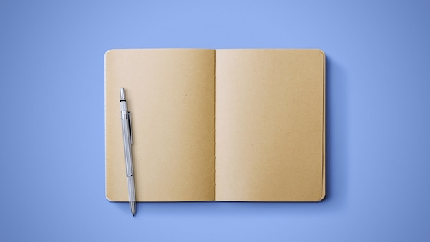 Old notebook with pen on blue background