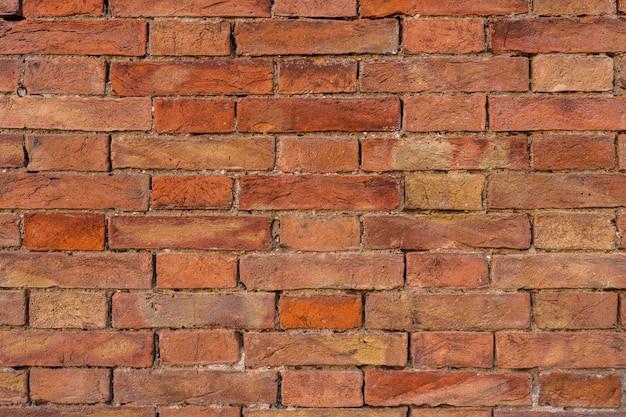오래 된 주황색 벽돌 벽 배경