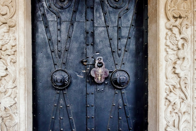 Old ornate church door with a lock
