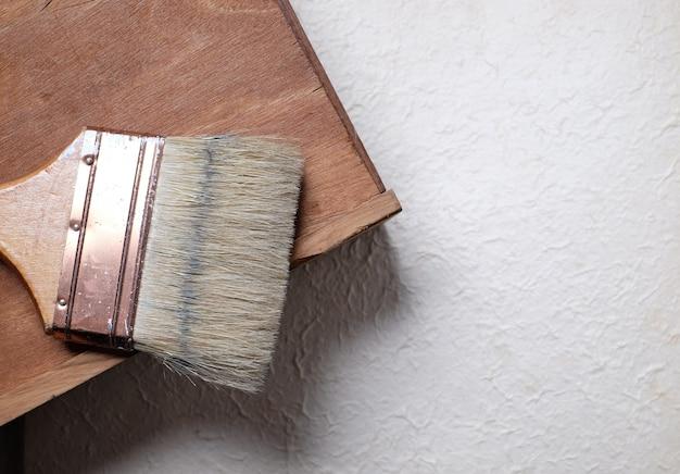 Old paint brush on wood.