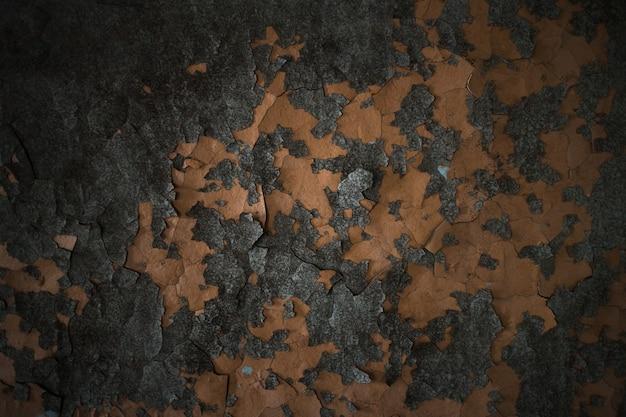 コンクリートを剥がす古いペンキの質感。壁の背景。