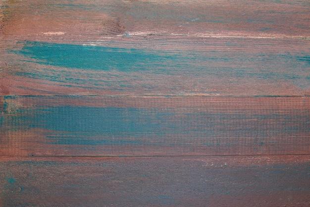 Vecchia superficie strutturata dipinta per sfondo.