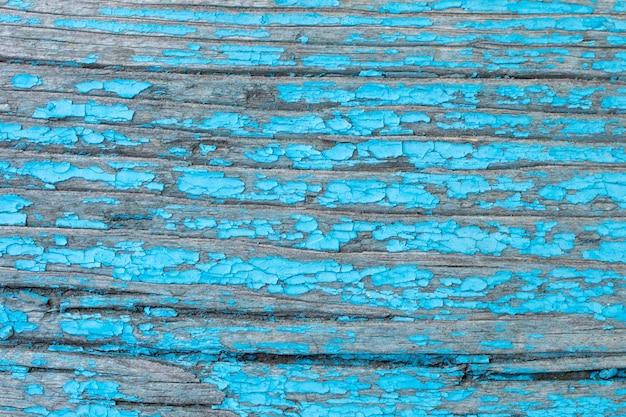Старая покрашенная деревянная стена - текстура или фон.