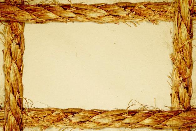 ロープ上の古い紙の背景