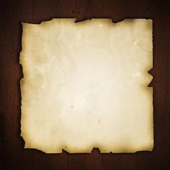 木製の背景に古い紙