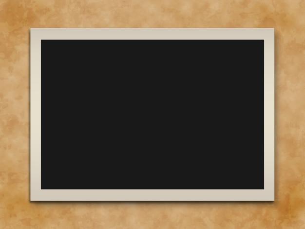 Old paper photo frame on grunge background