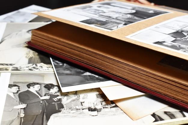 Old paper retro photo album with family photos. family photo archive.