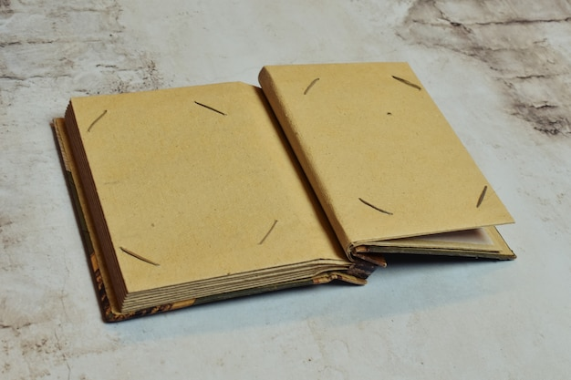 Old paper retro photo album with place for your text.   family archive.