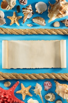 Old paper and seashell on wooden background texture