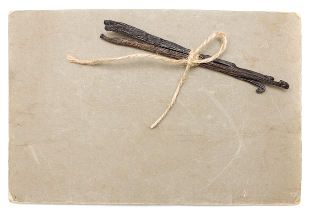 Old paper with vanilla beans isolated