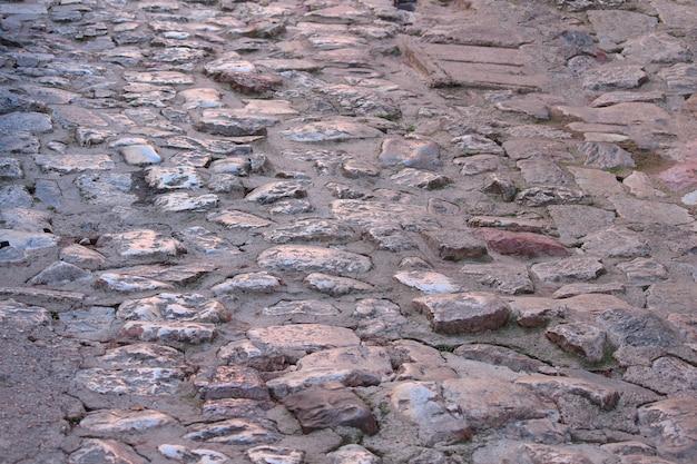 오래 된 포장 돌 빈티지도로 표지 배경입니다.