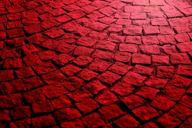 Old paving stones at night in red light