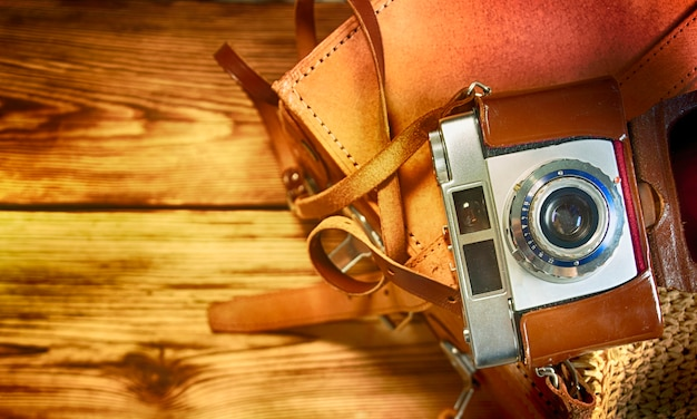Old photo camera, travel concept