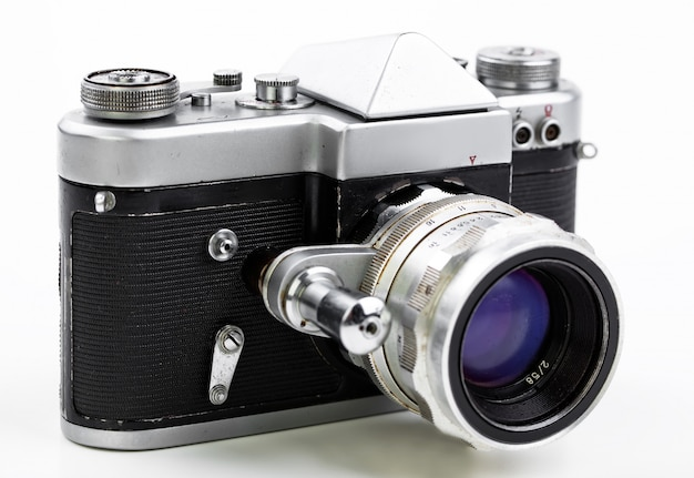 Old photo camera on a white background