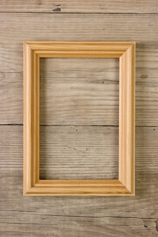 Old picture frame on a wooden background