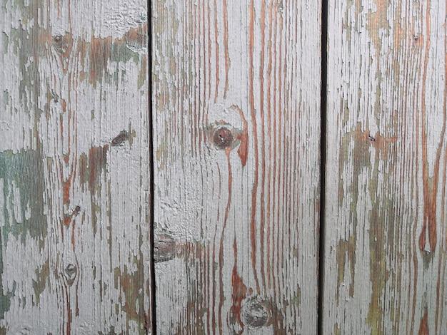 剥離ペイント抽象的な背景フラットレイコピースペースと古い板の表面