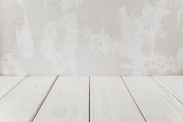 白い木の床、クローズアップと古い漆喰壁