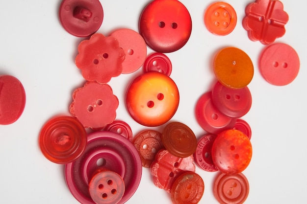 Old plastic buttons in different colors on the background. tinting