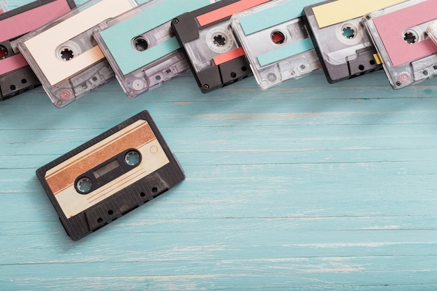 Old plastic cassette on blue wooden. retro music concept