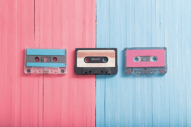 Old plastic cassette on wood background