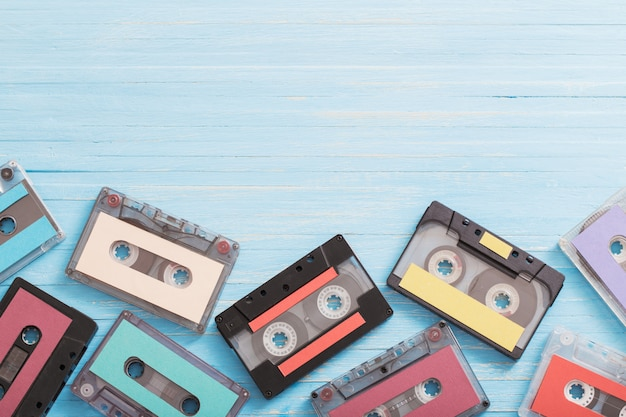 Old plastic cassette on wood. retro music concept