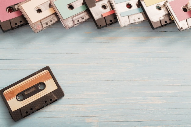 Old plastic cassette on wooden surface