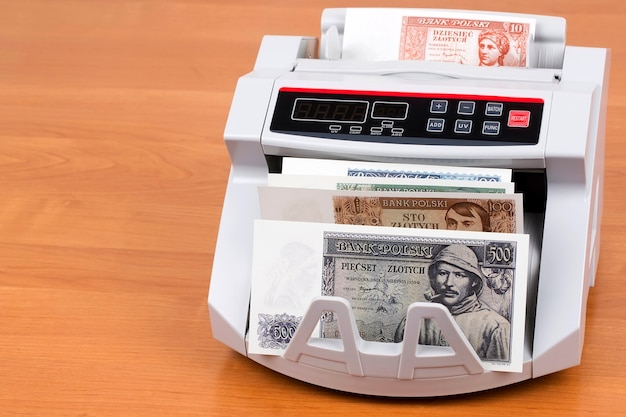Old polish money in a counting machine