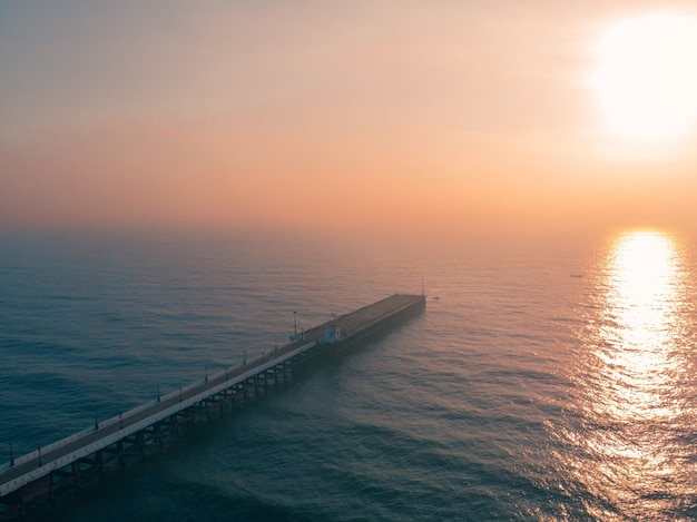 Old port pier in pondicherry rock beach during the sunset