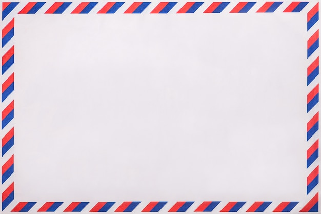 Old post striped envelope, background with copy space. mail letter with stripped vintage pattern.