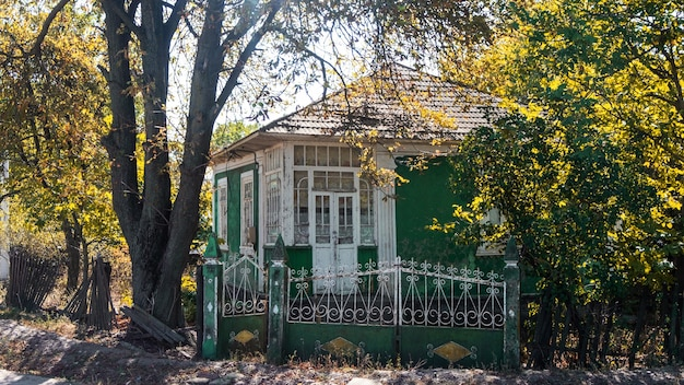 Old provincial dwelling house with green facade in moldova