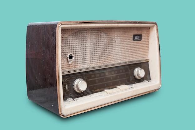 Old radio isolate on green
