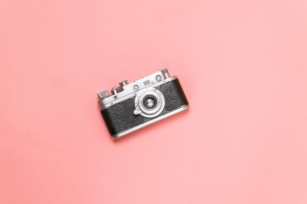 Old rangefinder camera on a pink background