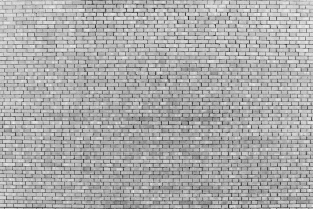 白いレンガで作られた古い現実的なレンガの壁