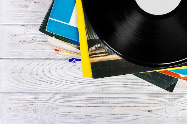 Old records stack. vintage on wooden background