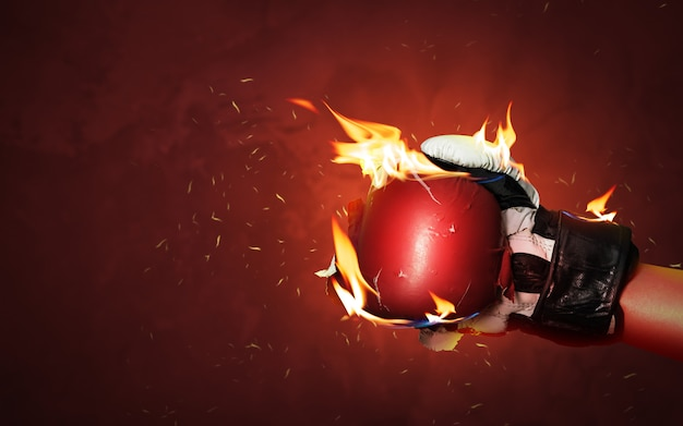 Old red boxing gloves on hot sparkles background with extreme fire flame and fighting fiercely hand for winner or success concept.