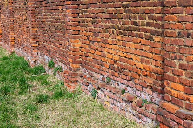 Old red brick fence from used broken brick