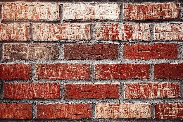 古い赤レンガの壁の正面のテクスチャの背景