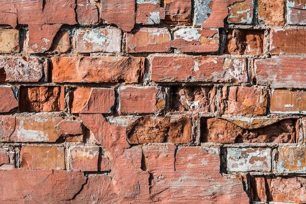 Старая красная кирпичная стена, предпосылка grunge горизонтальная.