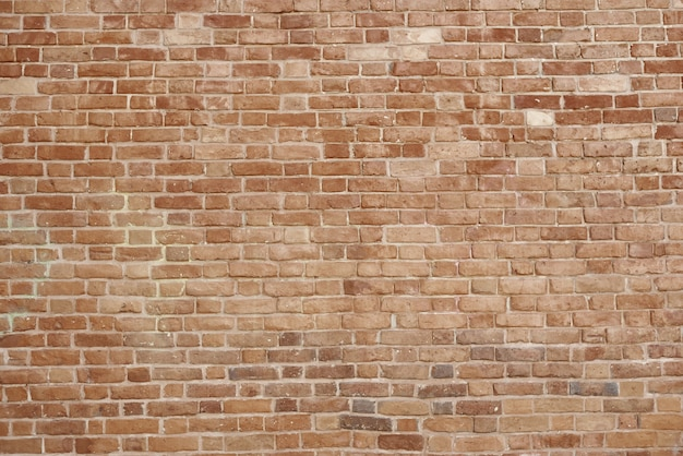 Old red brick wall texture background. great for graffiti inscriptions