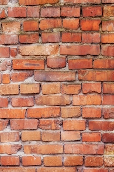 Old red brick wall texture, vertical surface