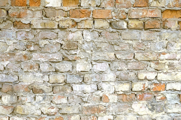 Old red brick wall with white paint background