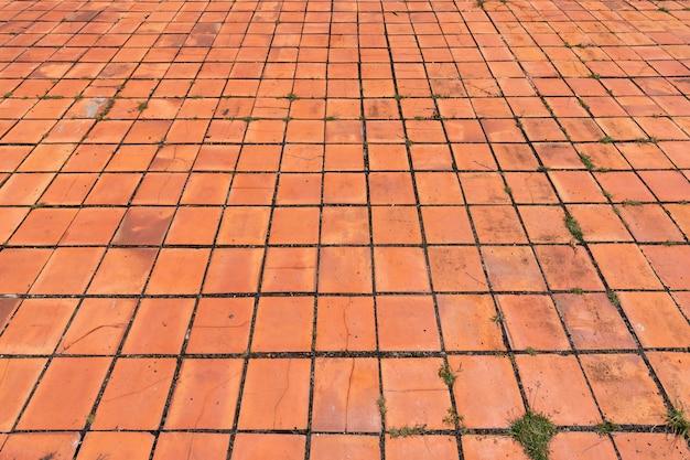 오래 된 붉은 갈색 벽돌 바닥 패턴 질감입니다.