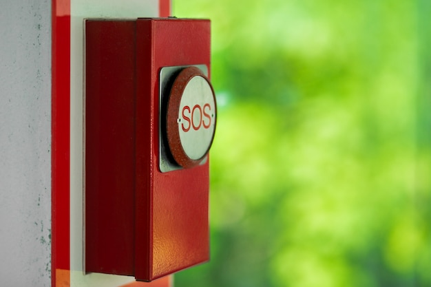 Old red emergency sos button in kuala lumpur park