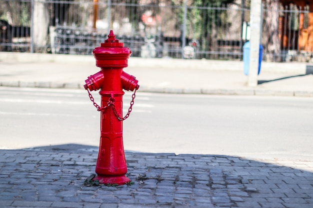 Old red fire hydrant in city street.  red hydrant fire detail prevention system