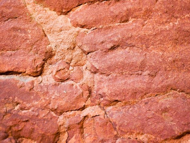 古い赤い大理石。背景テクスチャ。閉じる。碑文の場所