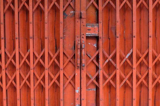 Old red rusty antique slide steel door