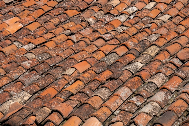 Old red tiles roof background, house roof. texture.