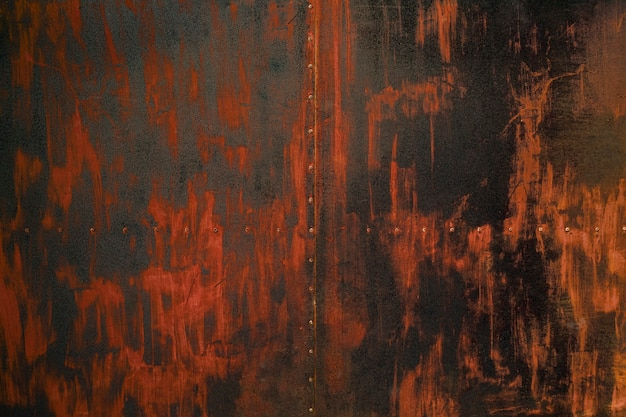 Старый красноватый металлический лист поверхности фон