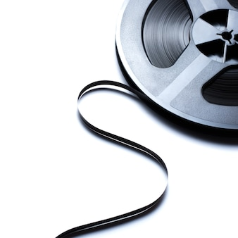 Old reel music tape on white background